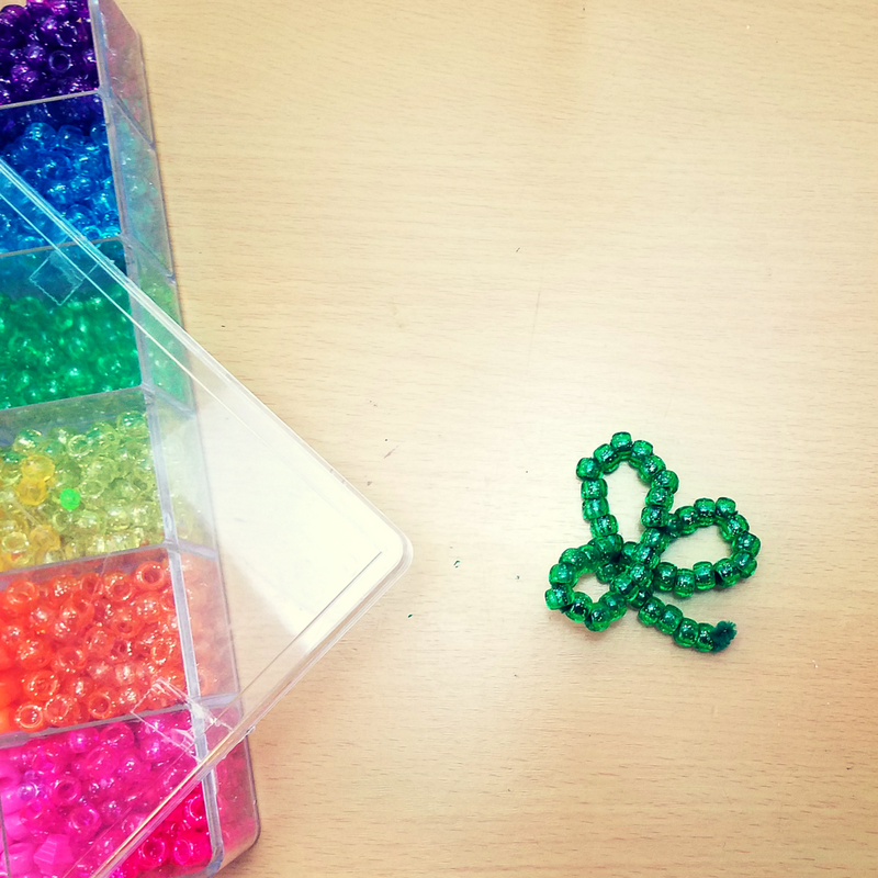 I love this beaded shamrock craft because it helps develop fine motor skills and hand strength. Did you ever realize how amazing crafts can be for kids? It helps them develop fundamental skills needed in life while developing their creativity. It also builds bonding moments and excites them about learning. I always like to tie a craft with a learning activity.