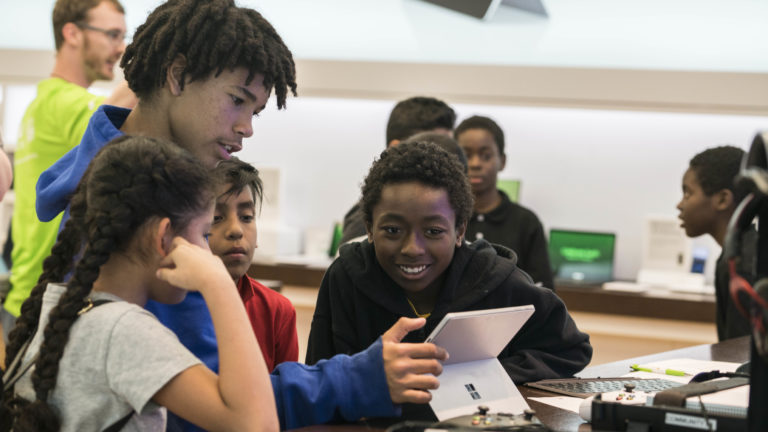 Students learn the basics of building video games with MakeCode Arcade during a free Microsoft Store Summer Camp.
