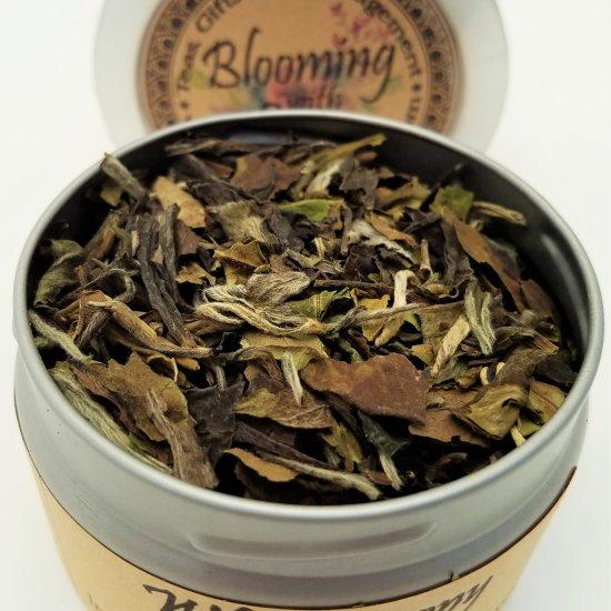 white peony tea blooming with joy