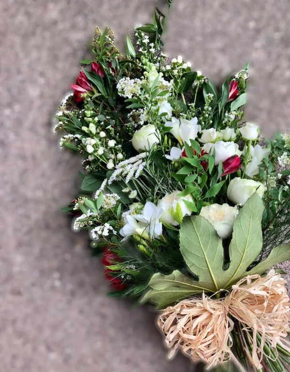 Hand tied funeral flower bouquet