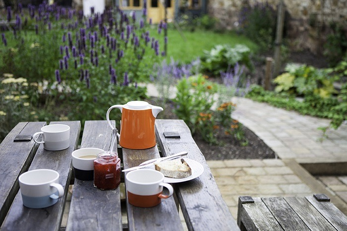 Breakfast in landscaped garden
