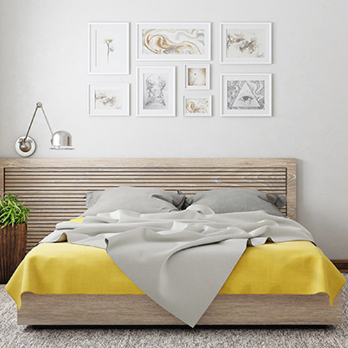 Bedroom wall art design with photo frames