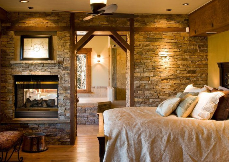 Bedroom With Stone Fireplace