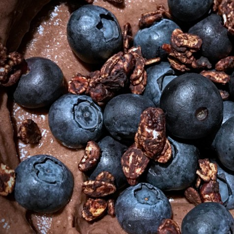 Chocolate nice cream with blueberries and chocolate granola