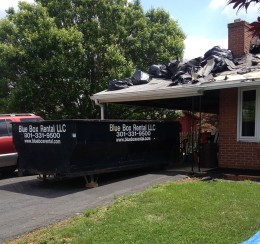 Roofing job is easier with a rented dumpster from Blue Box Rentals