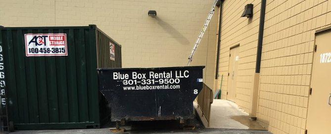 Blue Box Rentals rented dumpster in a tight spot on a commercial job site