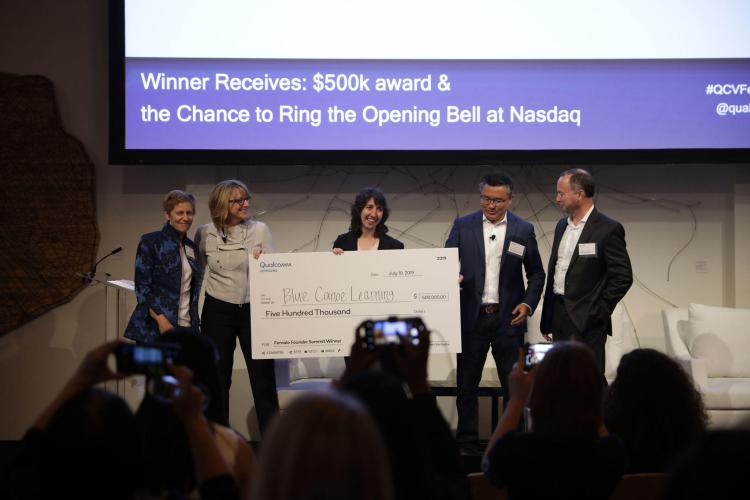 Sarah Daniels accepting check at Qualcomm Ventures Female Founders Summit