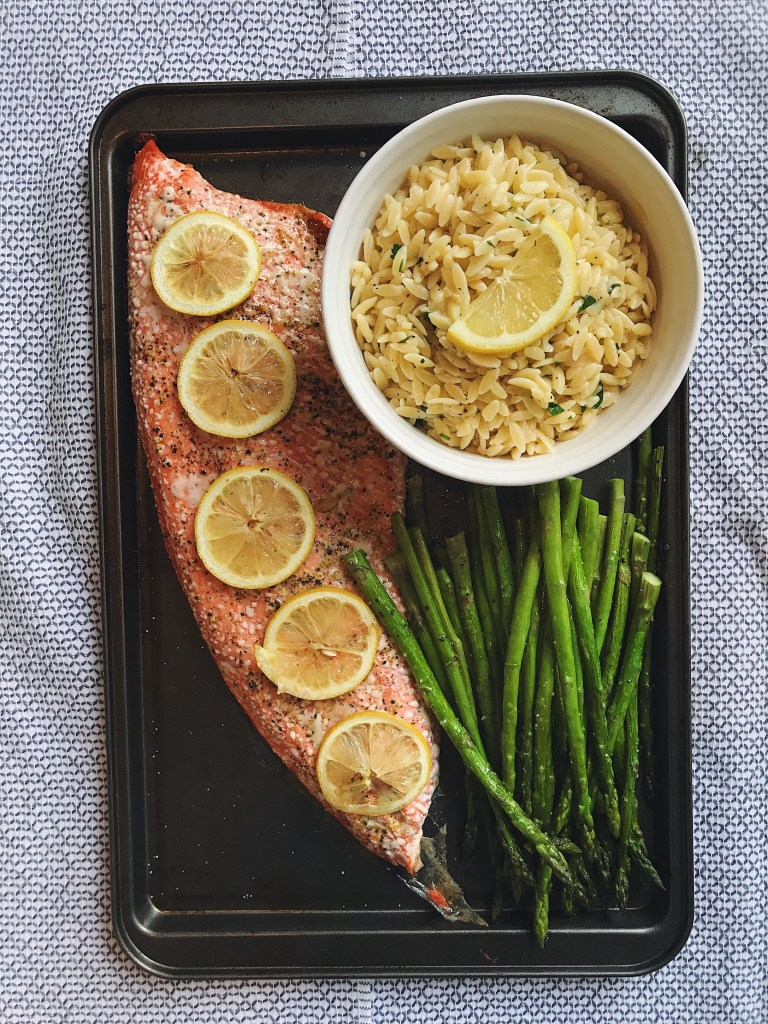 This easy Parmesan Lemon Orzo pairs perfectly with roasted sockeye salmon and asparagus. It's an easy weeknight meal you'll love! Find the recipe at bluecheesebungalow.com