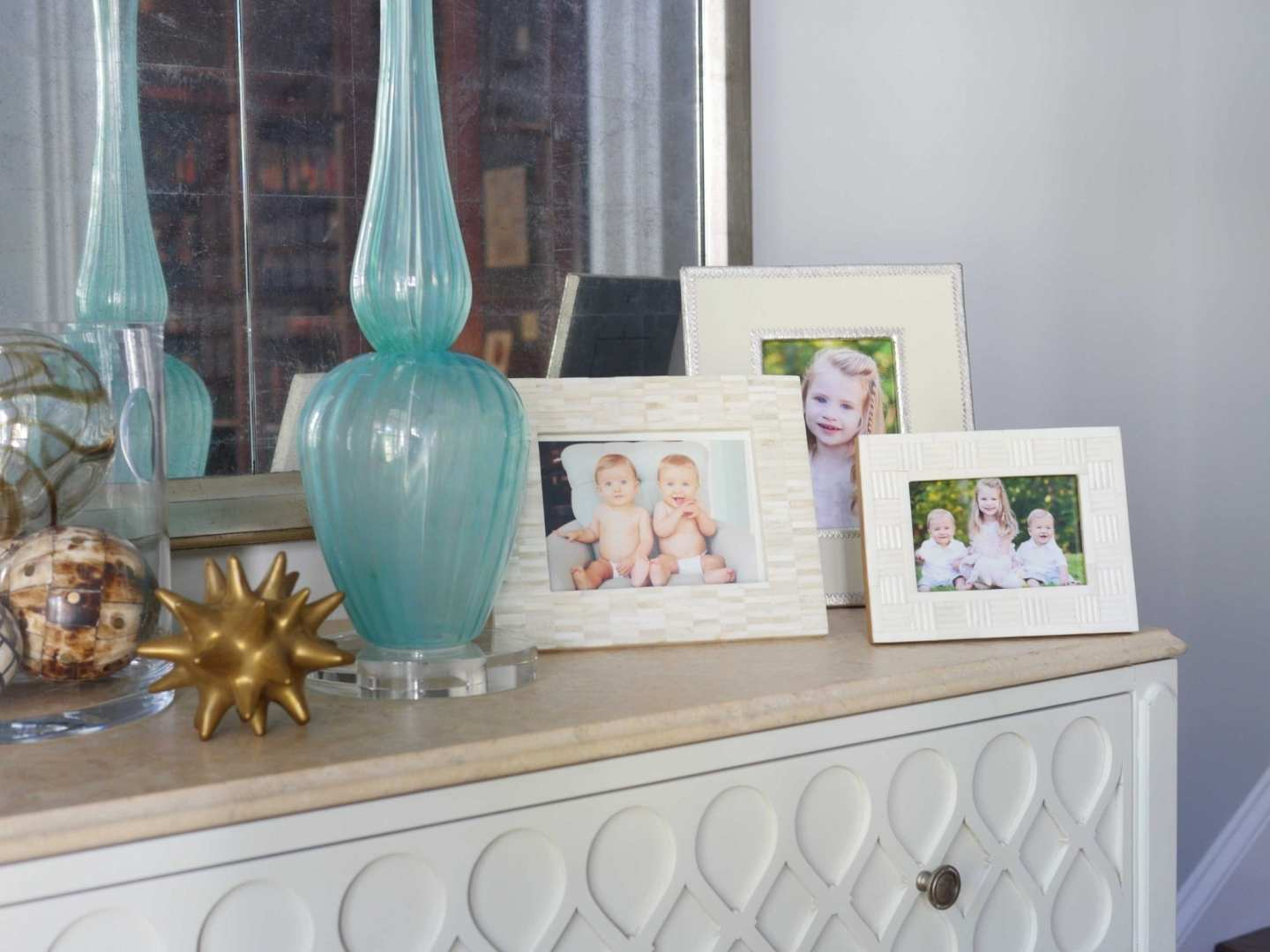 Foyer Entry Decor with ivory picture frames.