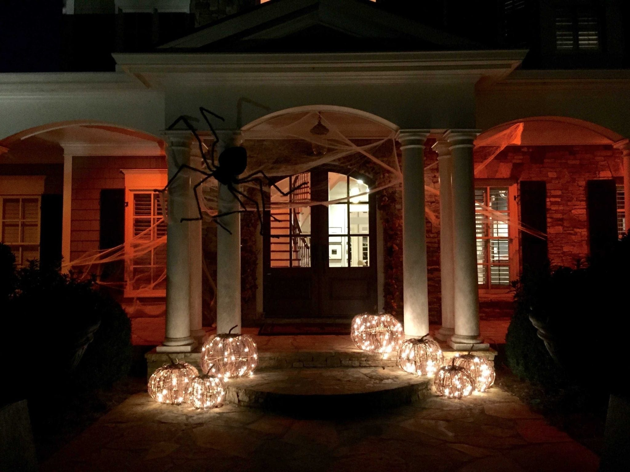 Outside house with orange lights.