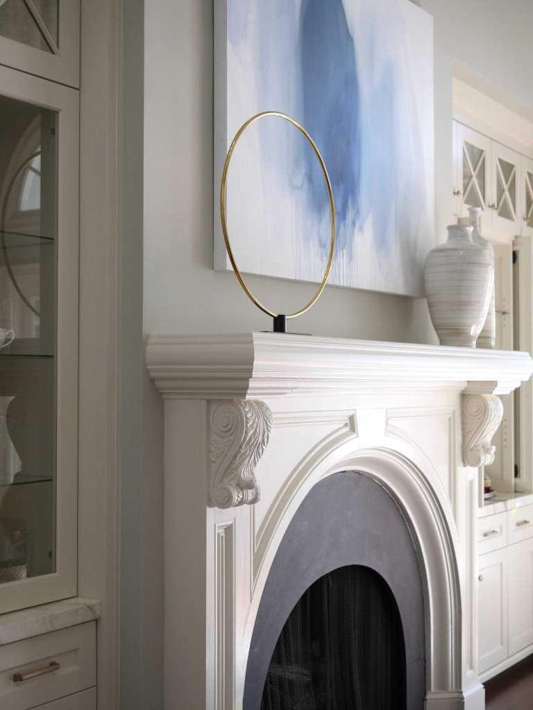 White mantel decor. Simple mantel decor and blue paint colors.