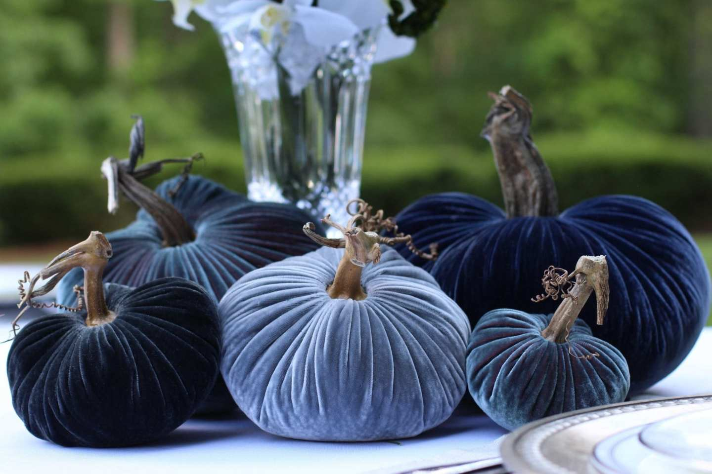 blue and gray velvet pumpkins that are exclusive plush pumpkins for bluegraygal on a table