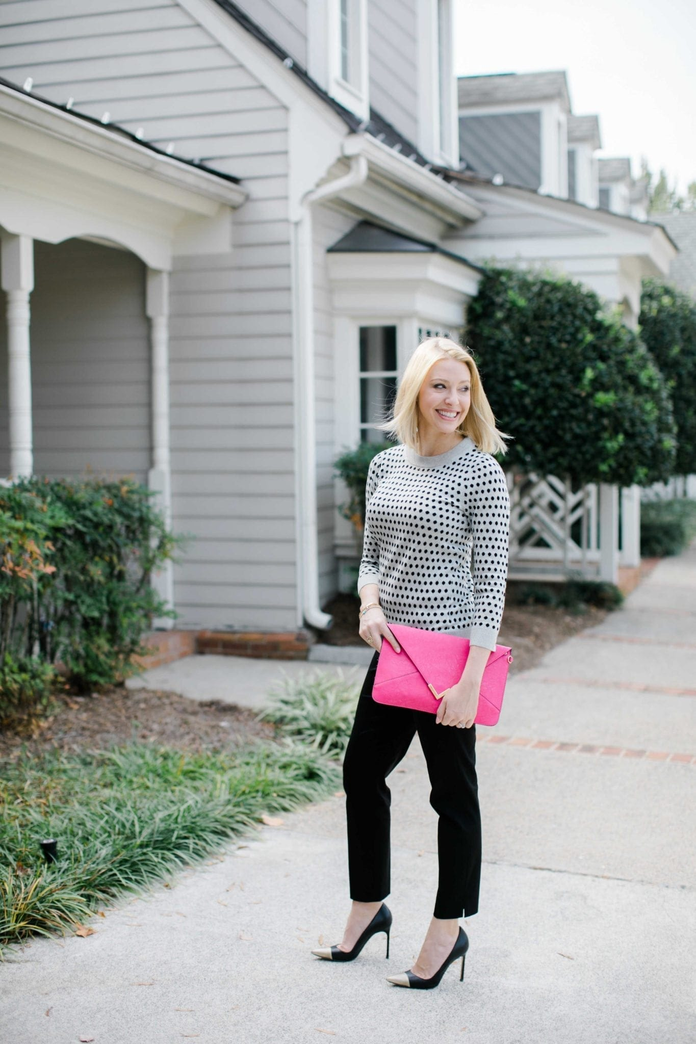 bluegraygal wearing polka dot sweater that is gray with black polka dots