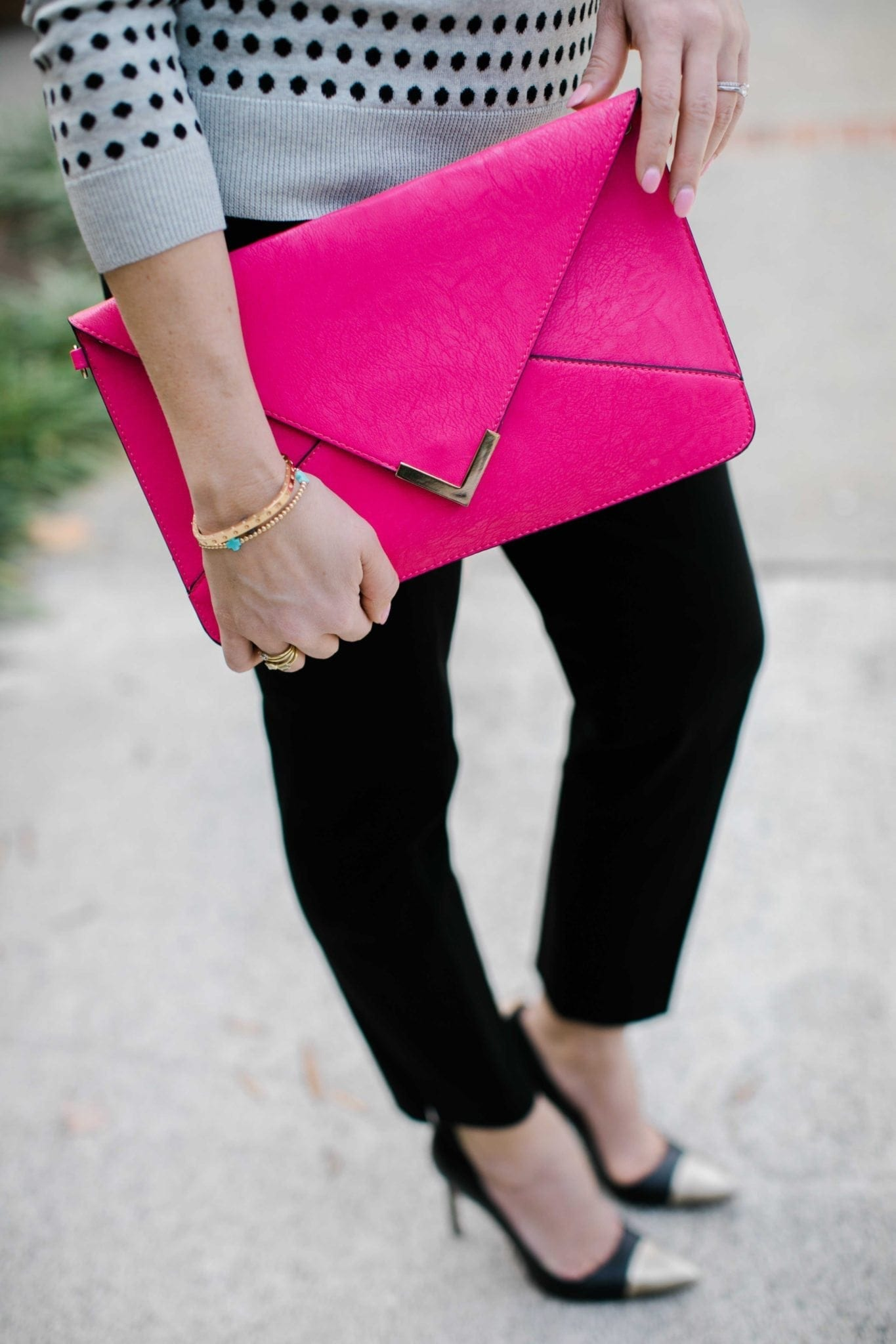 hot pink clutch purse with gold with black and gray outfit