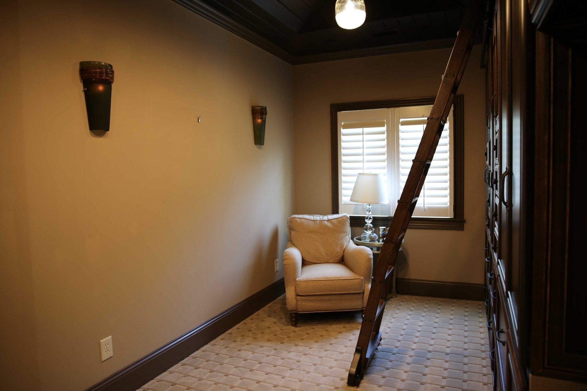 office with dark wood ceiling and yellow walls and brown trim