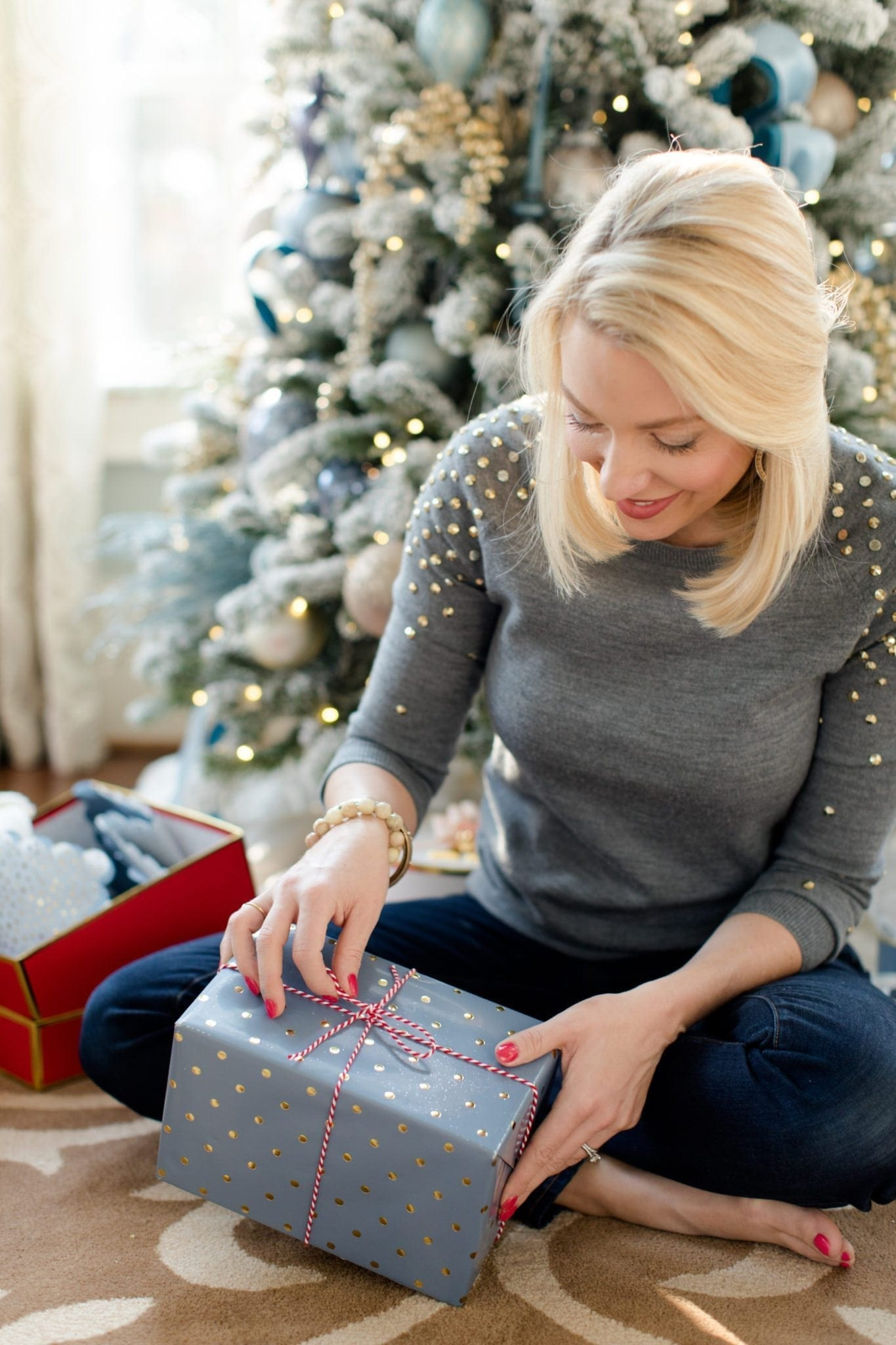 Lifestyle blogger Kelly Page from bluegraygal wrapping present with Target Sugar Paper wrapping paper.