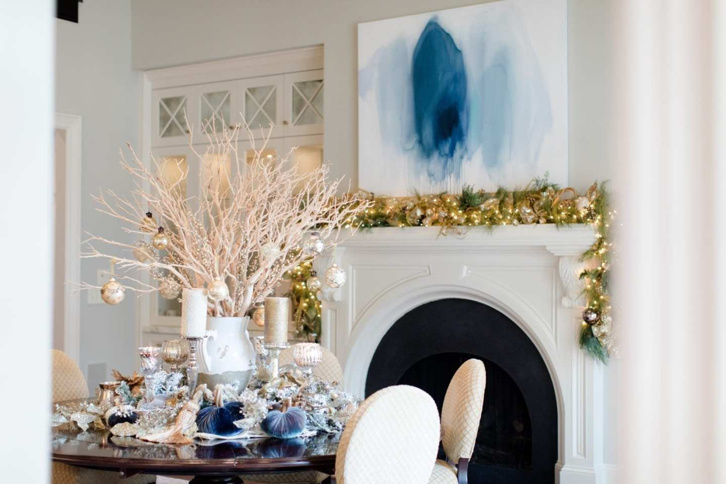 Dining Room with gold garland and Christmas decorations on dining room table with velvet pumpkins from bluegraygal in centerpiece.