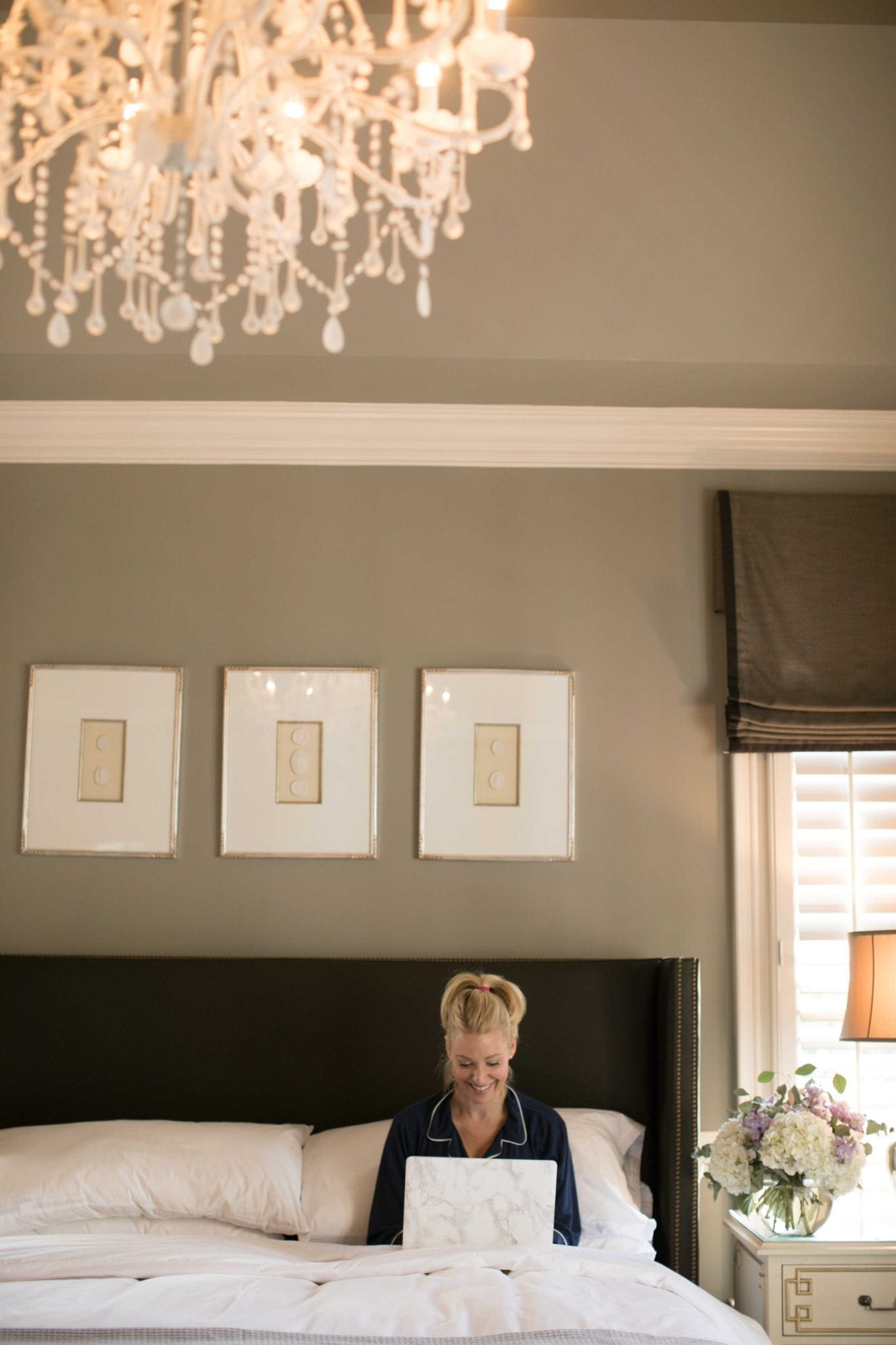 Squirrel Tail dark gray paint color recommendation. Brown headboard with white chandelier in master bedroom.