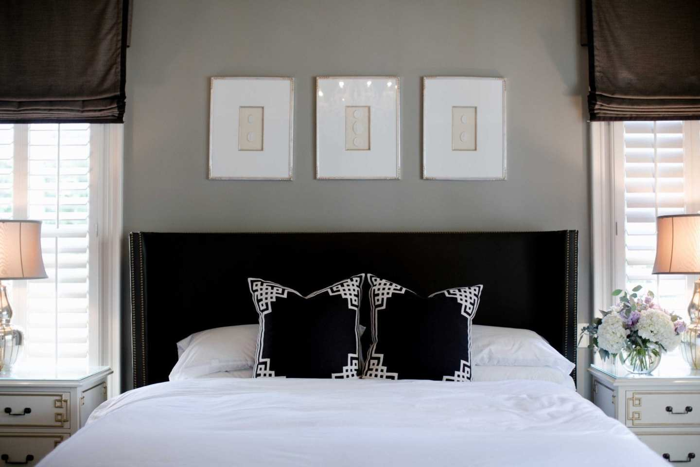 Dark master bedroom in gray and brown.