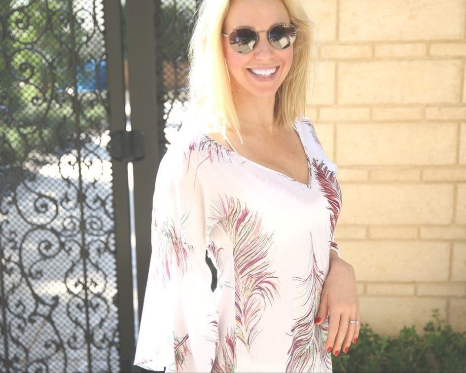 kelly page in bathing suit coverup at four seasons orlando