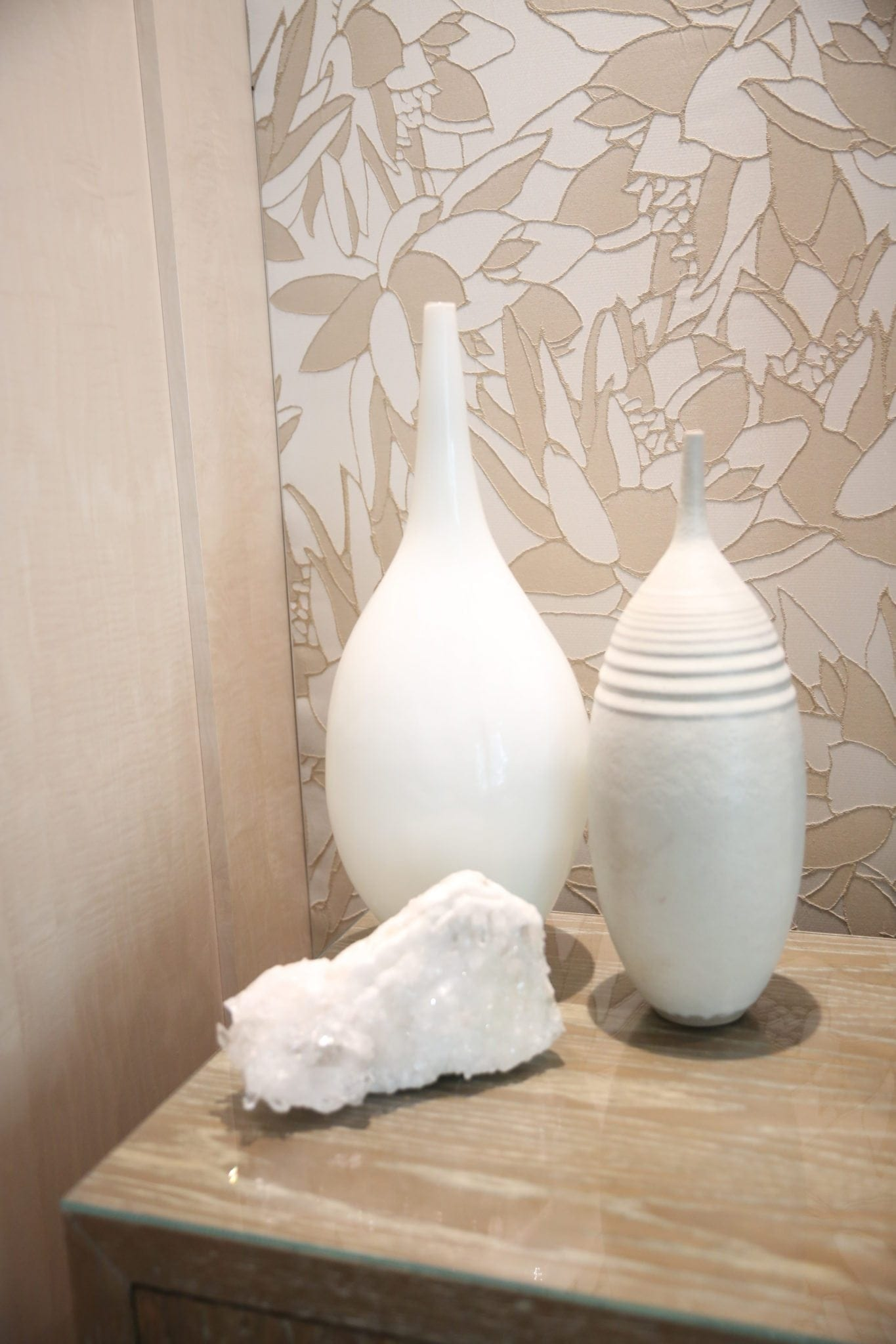 white urns for home decor with a neutral leaf wallpaper decor for how to decorate in neutral tones
