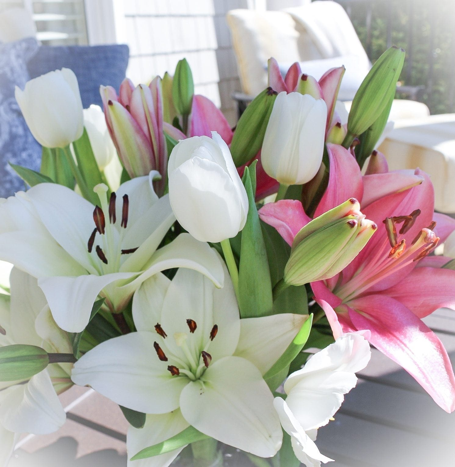 Easter flower arrangement of lilies and tulips for easy baby shower decor