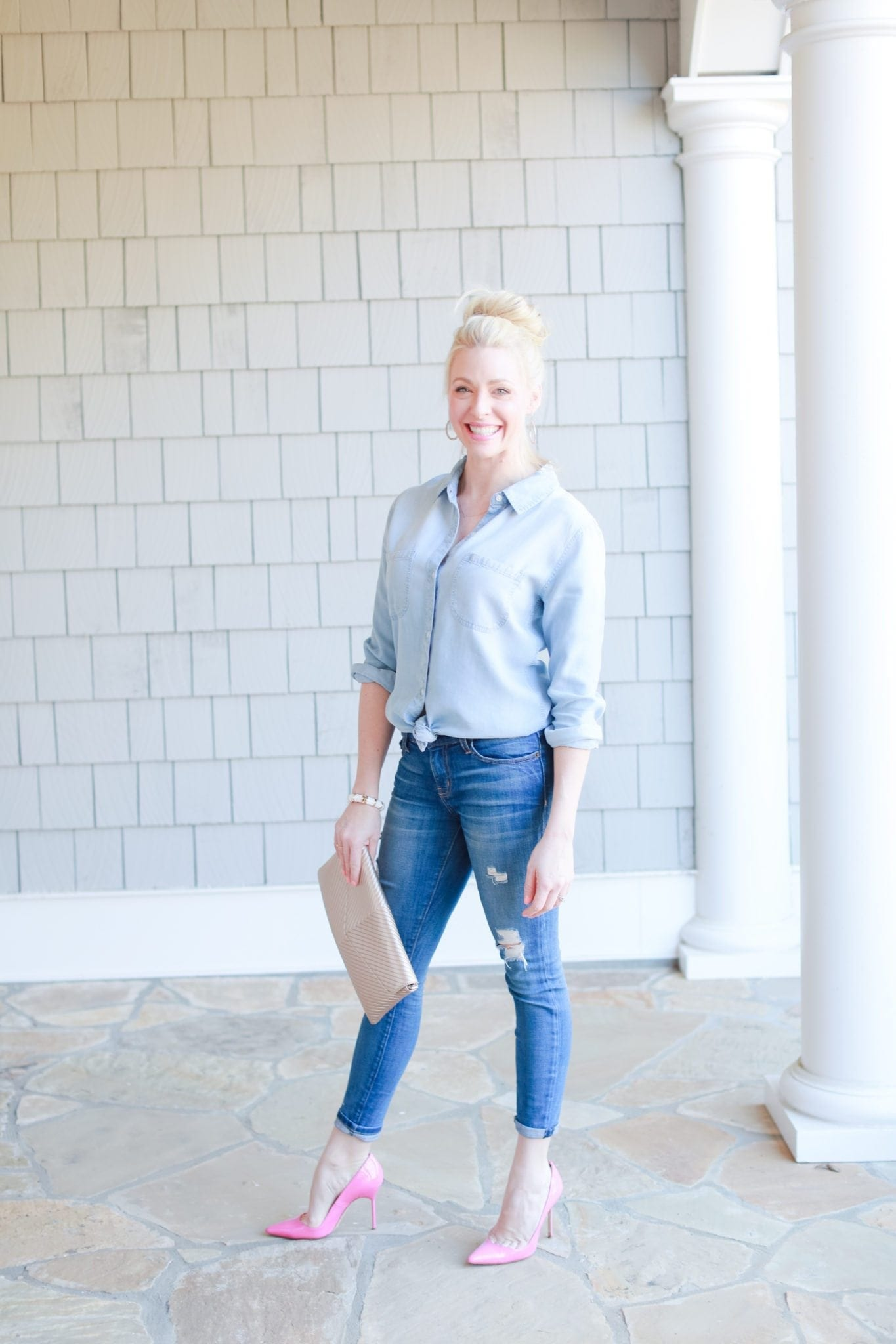 Chambray shirt and ripped jeans and pink high heals.