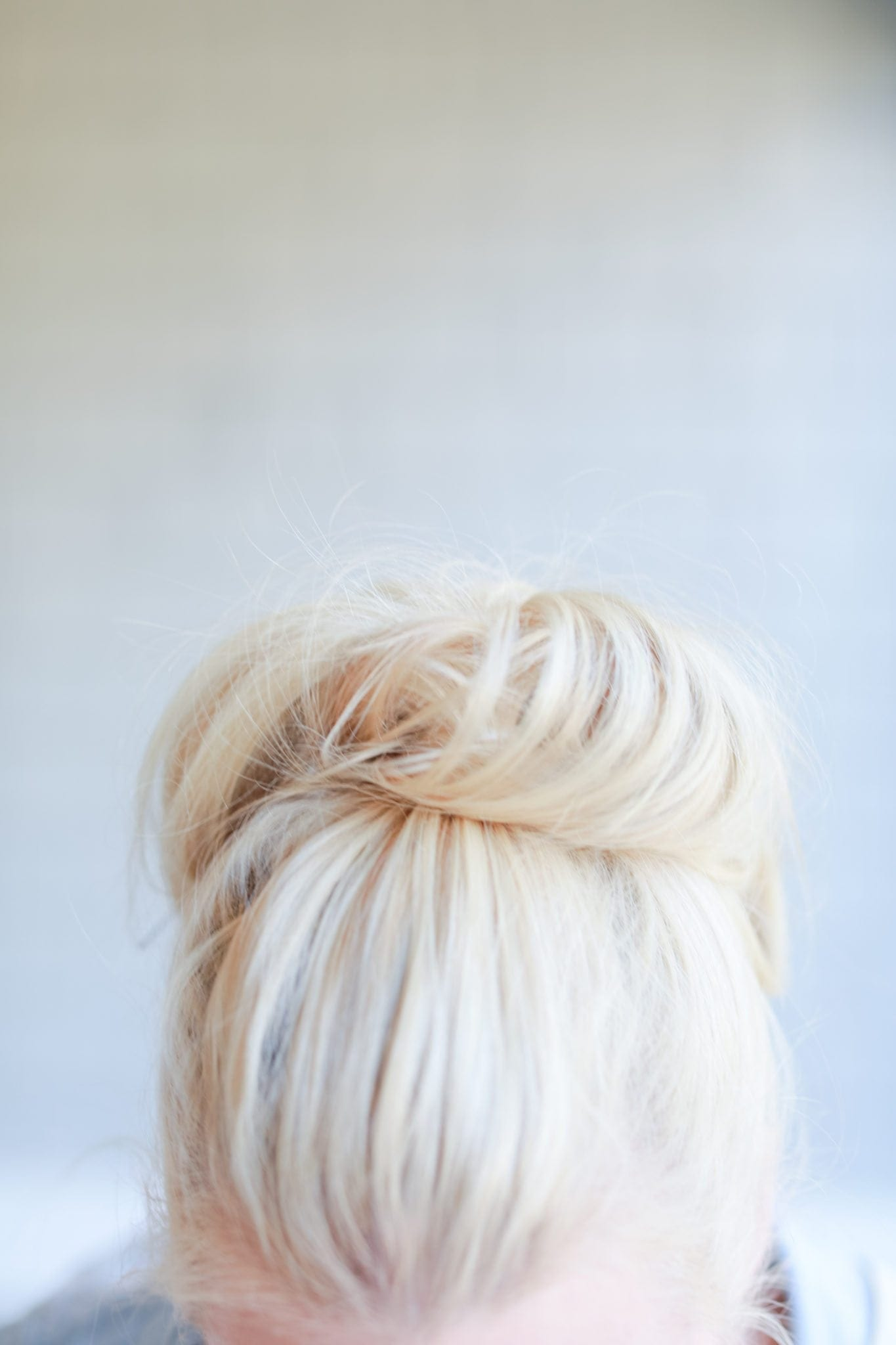 Blonde hair top knot for girls with short hair.