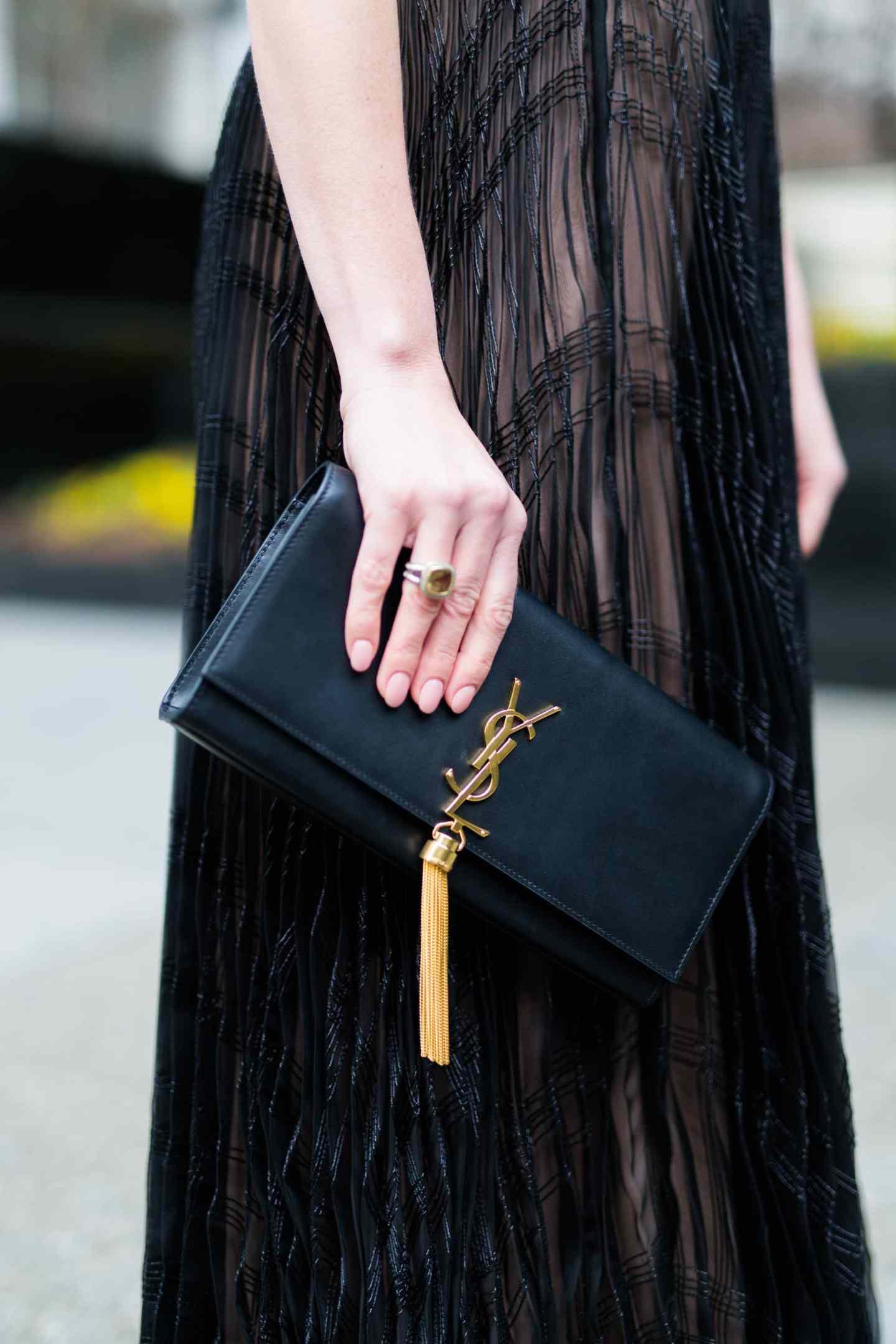 ysl tassel bag dupe. Black clutch with gold tassel.