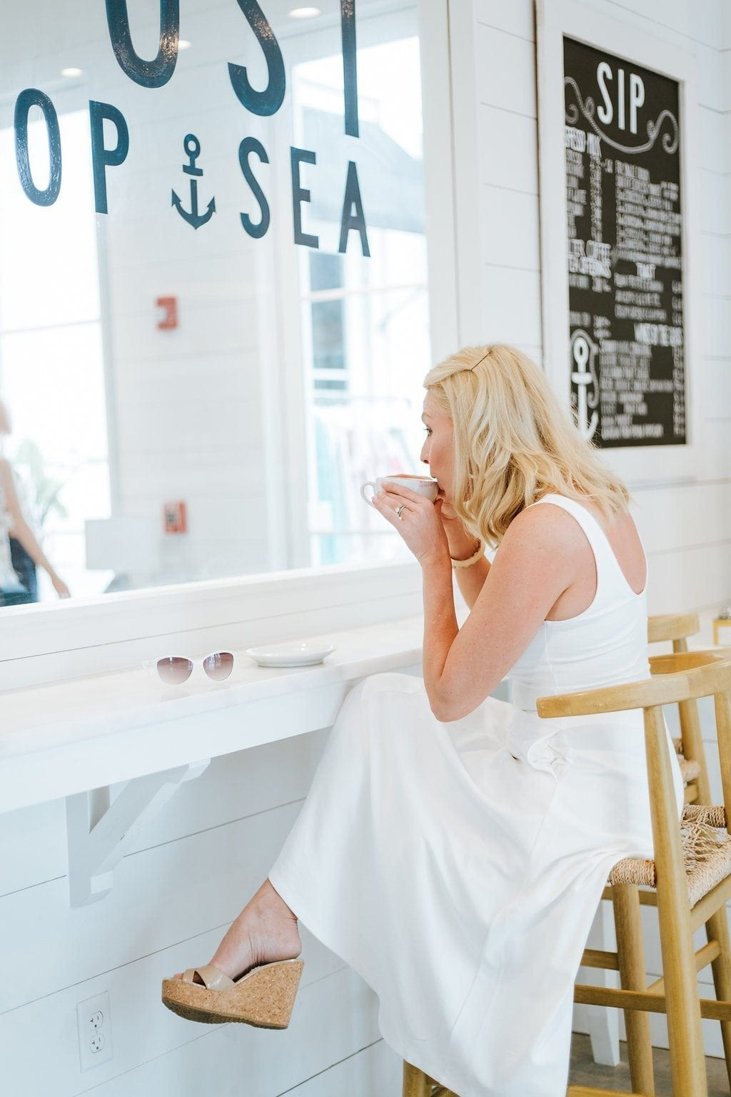 Rosemary Beach vacations. White dress in coffee shop. The Outpost in Rosemary Beach.