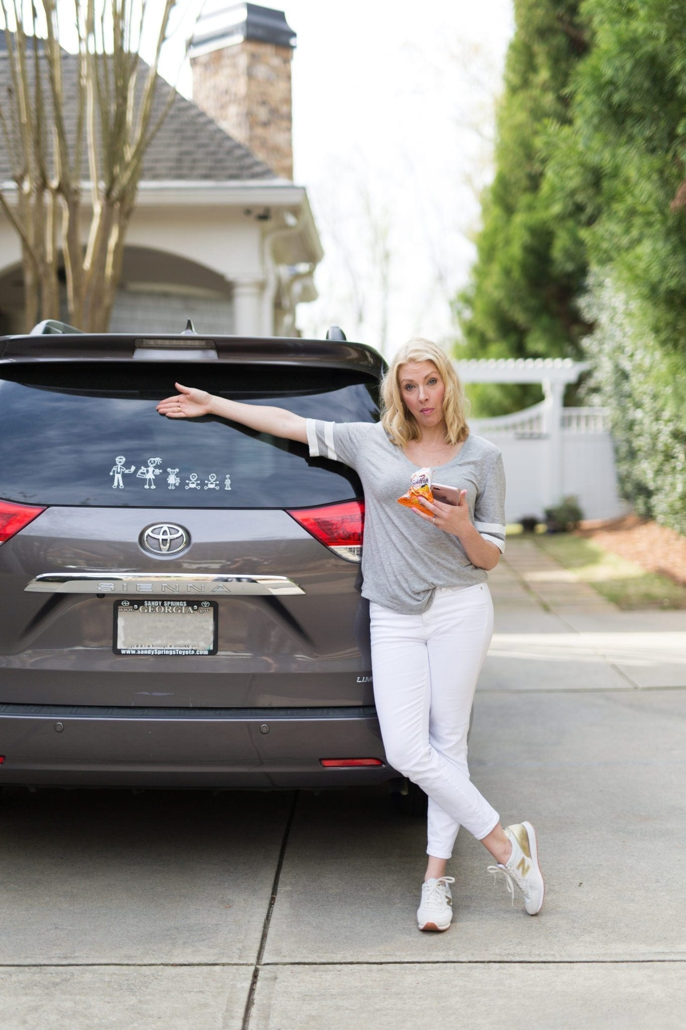 Minivan Mom lifestyle blogger. bluegraygal. White jeans, Gold and White tennis shoes and awesome sticker family.