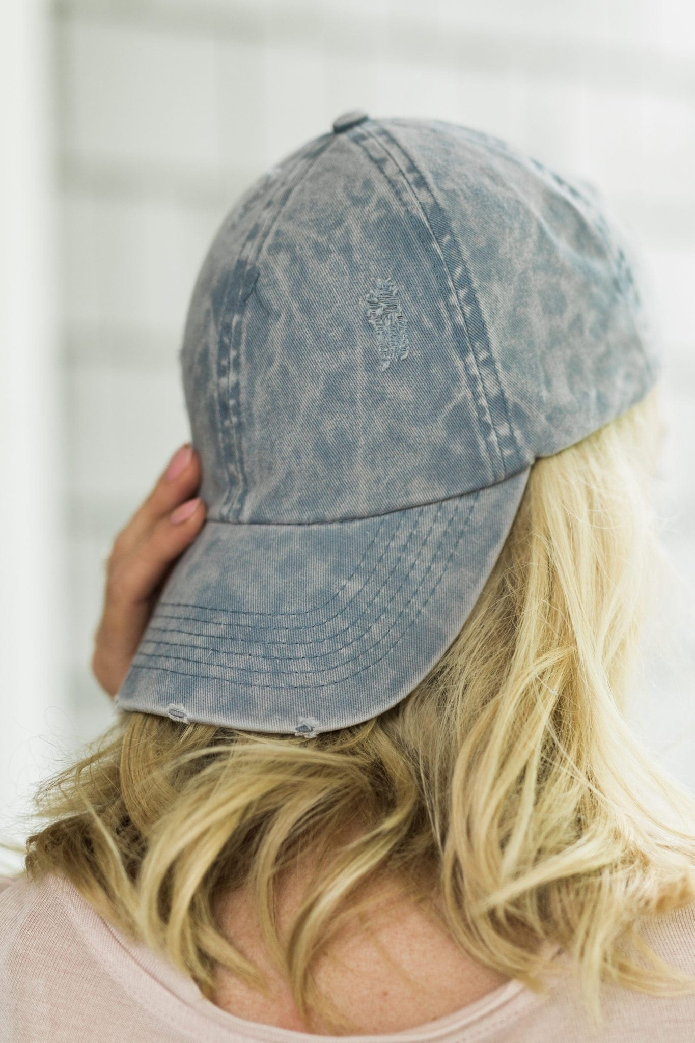 Women blue baseball hat. Distressed denim looks great with every outfit. It's a pale blue color hat with just enough distressing to still look polished but effortless. I love to wear my blue baseball cap with pigtails for an easy everyday hair look.