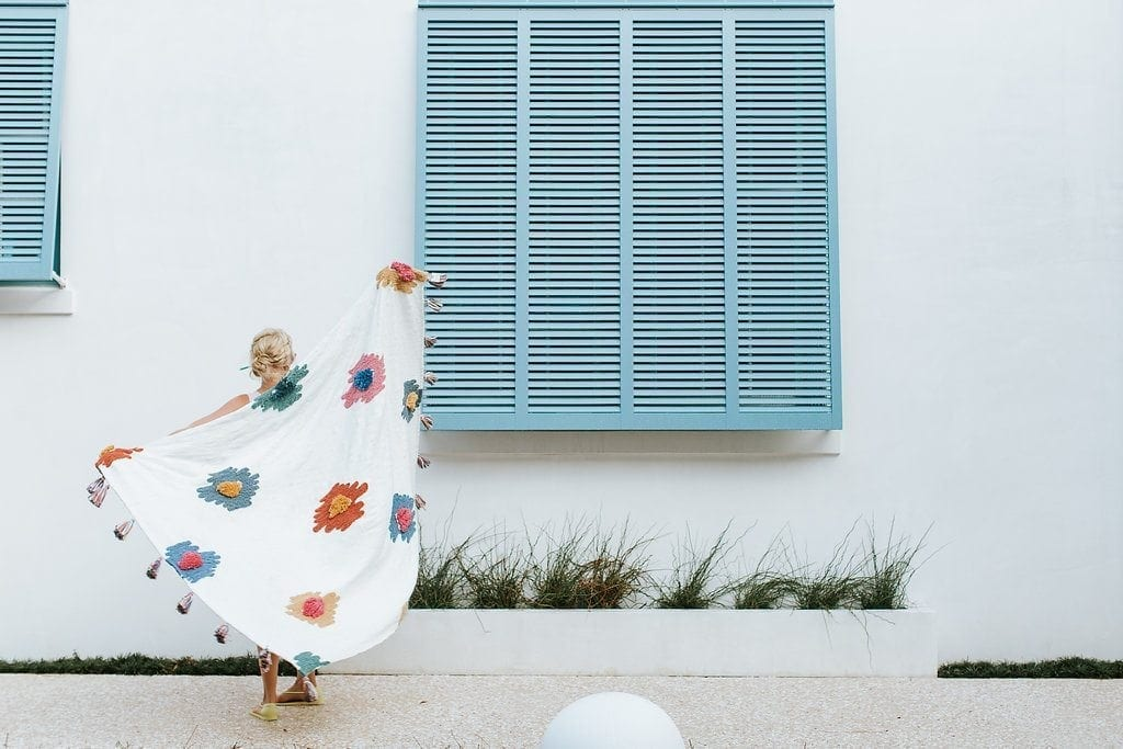 Atlanta blogger Kelly Page. Blue shutters and anthropologie blanket.