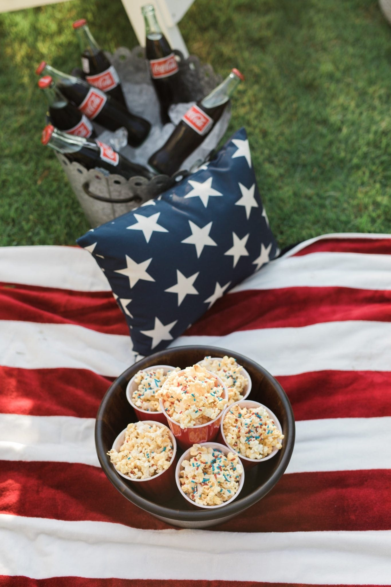 Popcorn with white chocolate and red white and blue sprinkles. 4th of july food ideas for kids
