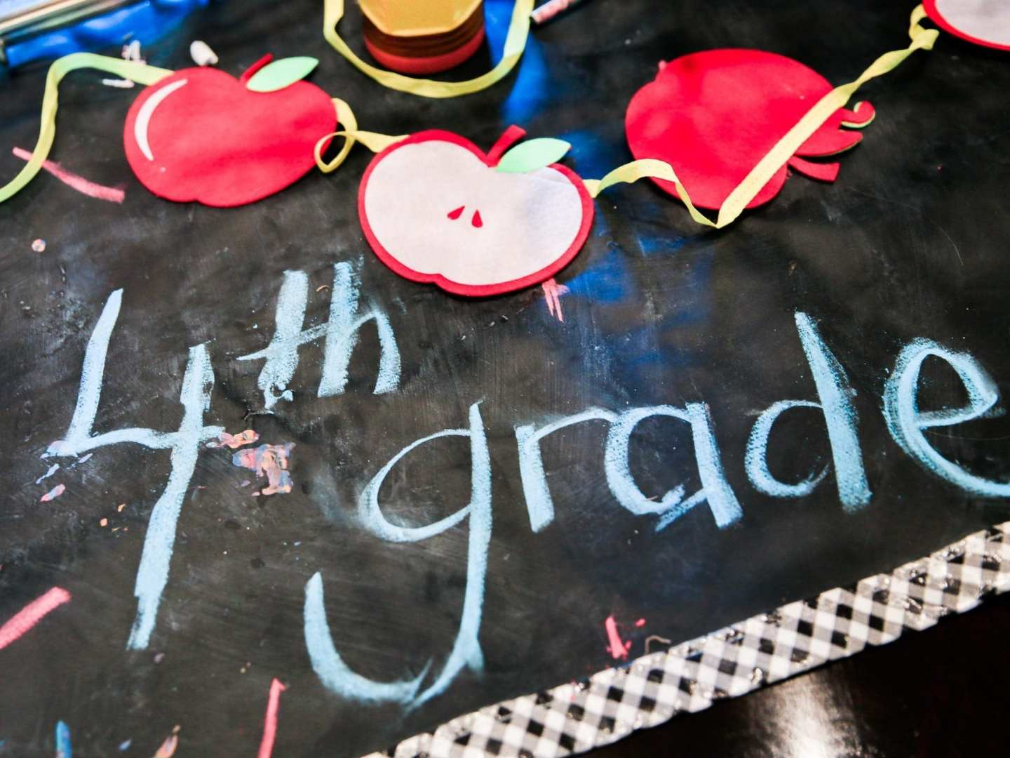 Chalboard mat with apple cut out garland for back to school decorations.