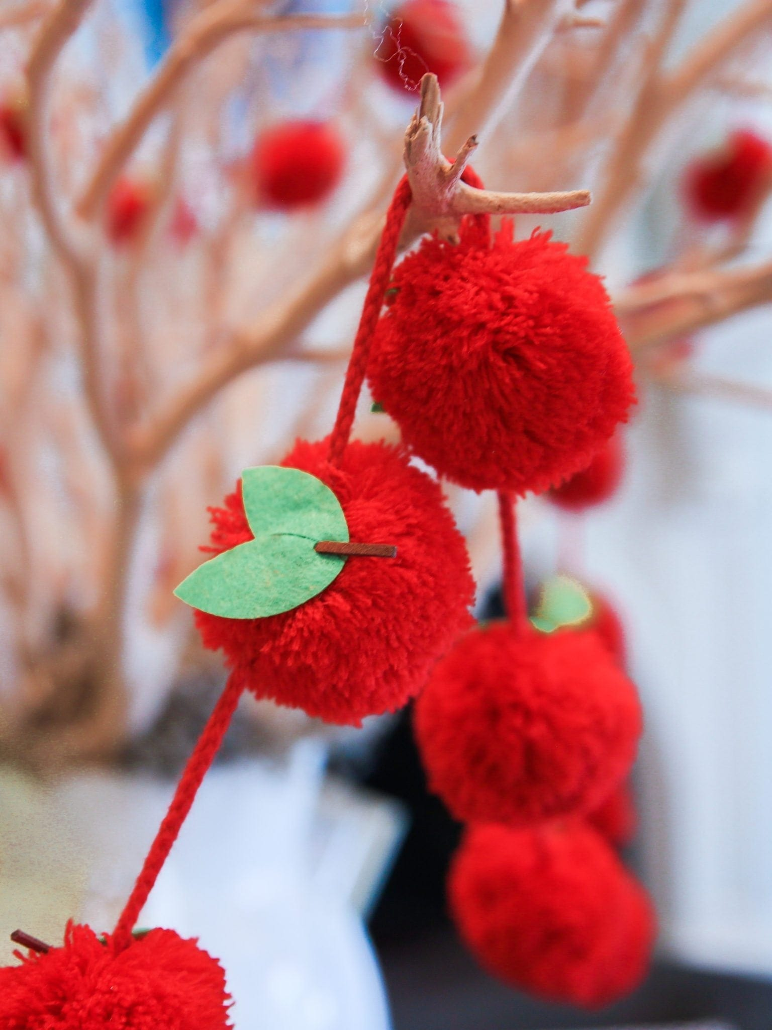 Red apple garland with apple pom poms