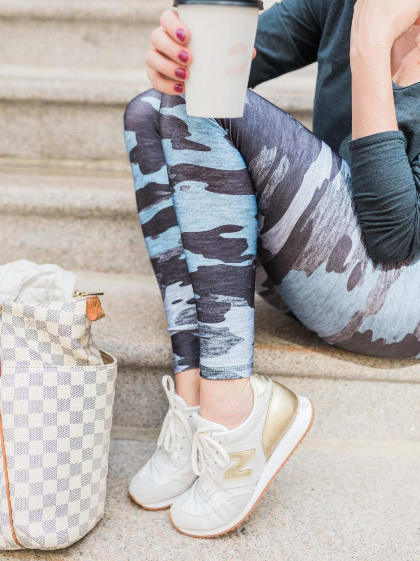 New Balance White and Gold Sneakers and blue camouflage leggings.