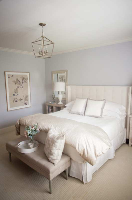 Bedroom decorated in ivory and pale lavender.