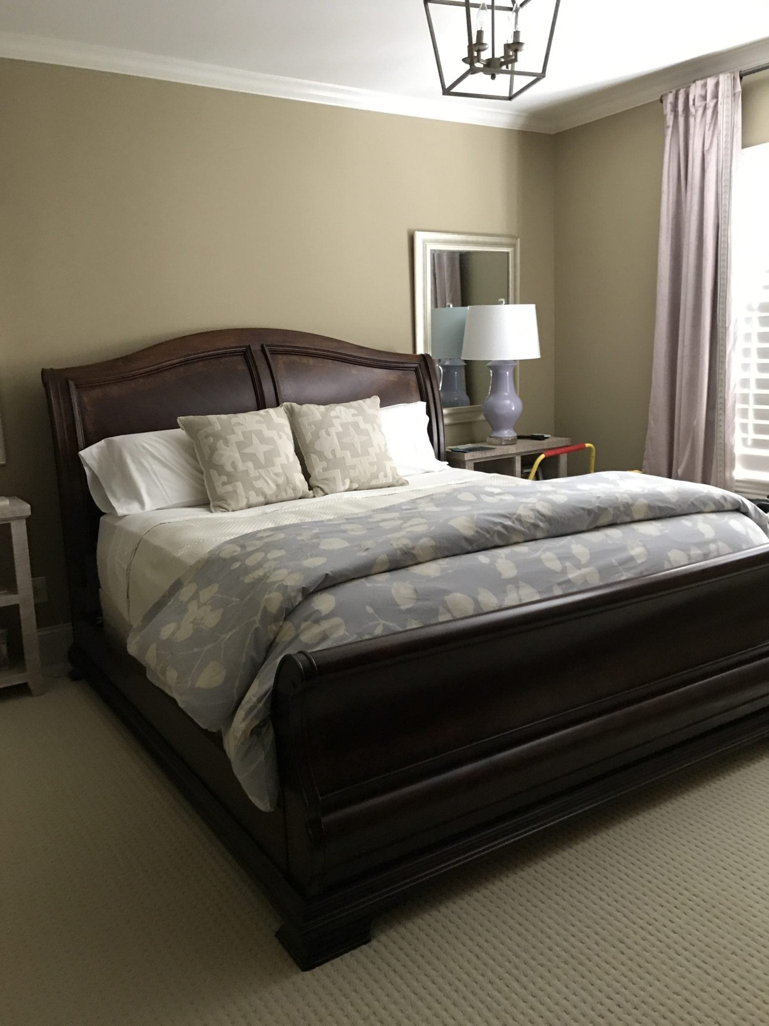 Dark Brown Sleigh Bed and Hunting Beige paint color from Benjamin Moore.