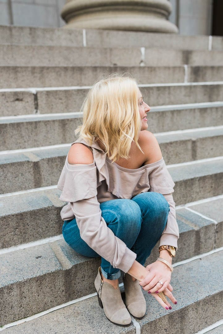 How to style booties with an off the shoulder slouchy sweatshirt.