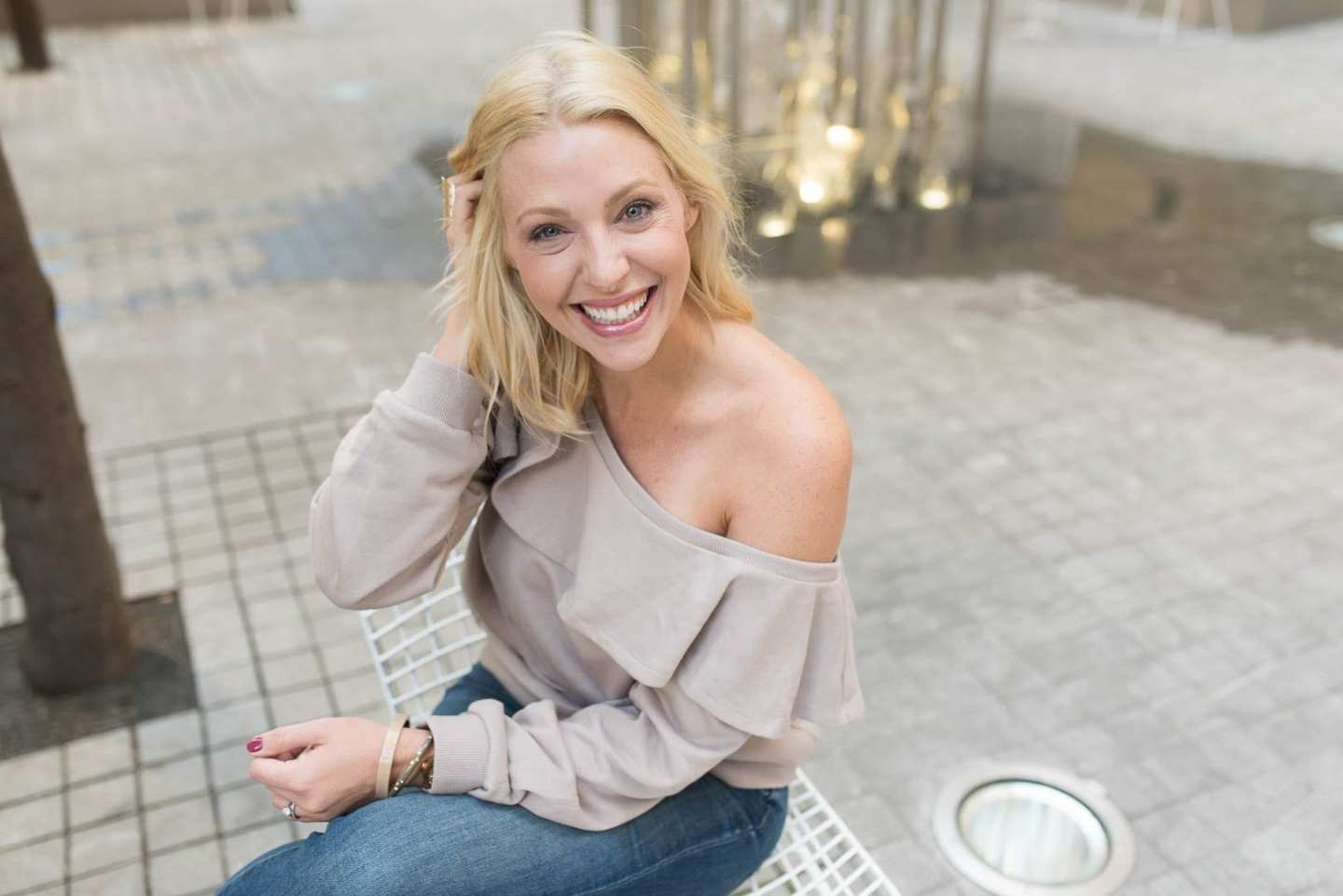 Kelly Page, bluegraygal, in an off the shoulder ruffle sweatshirt for a fall outfit ideas.