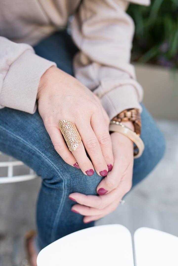 Kendra Scott gold rings.