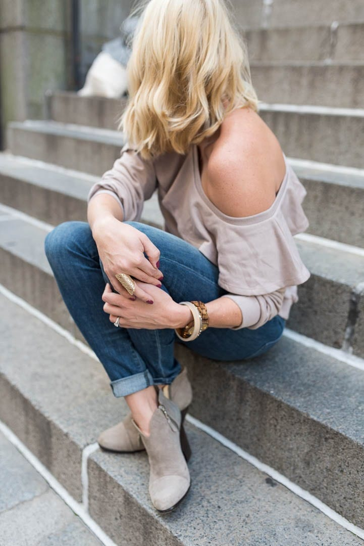 Word watch and off the shoulder sweatshirt. Cute short blonde hair style with beach waves and suede booties.
