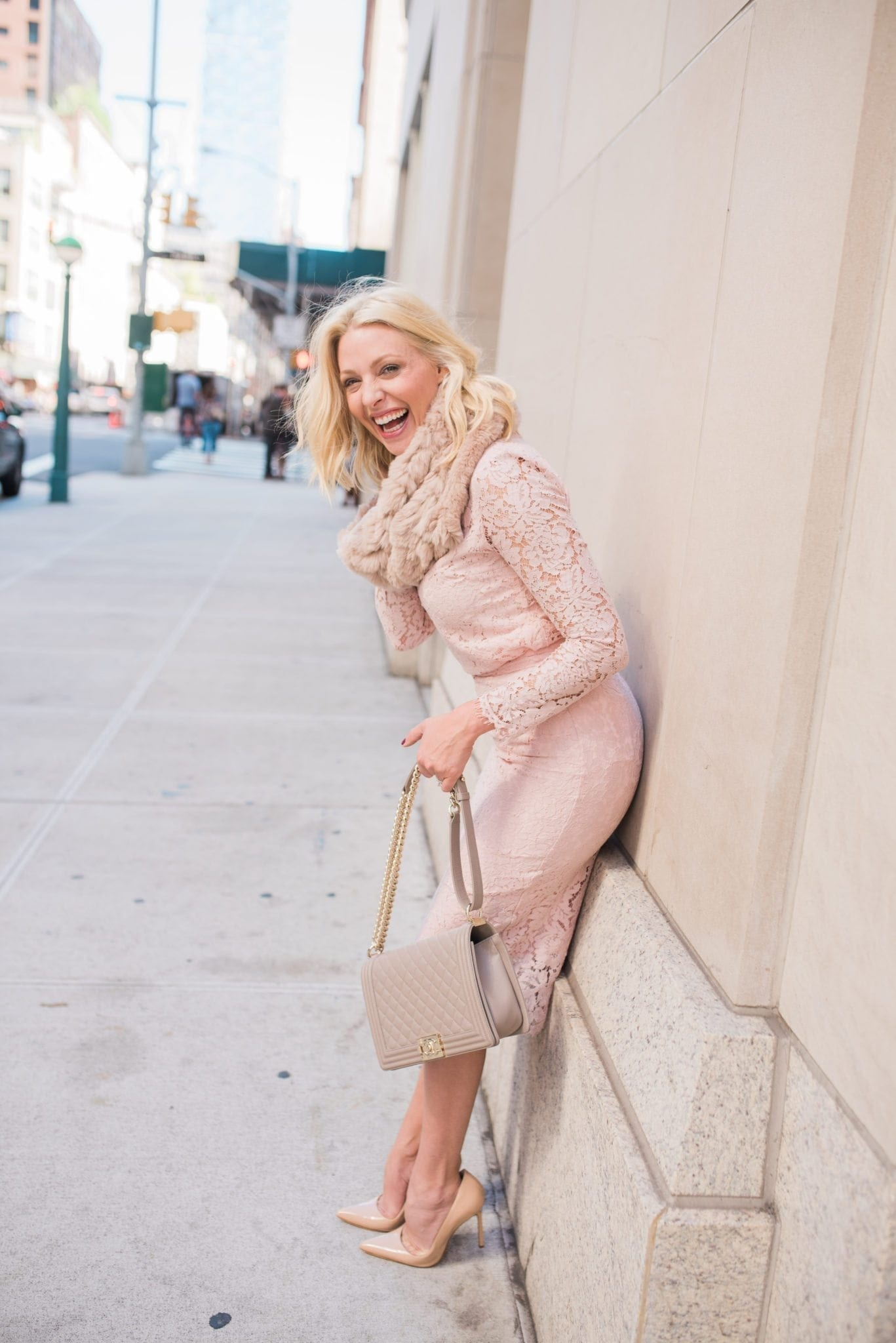 Short blonde hair on woman with pink formal outfit. Rachel Parcell clothing line review.