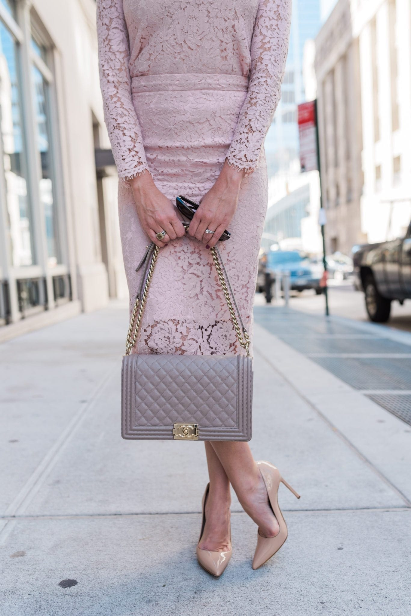 Neutral boy bag chanel and nude patent leather pumps with pink lace pencil skirt.