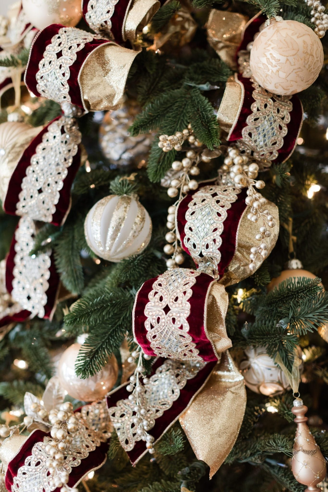 Ornament collection of gold and silver mixed in with ornate gold ribbon.
