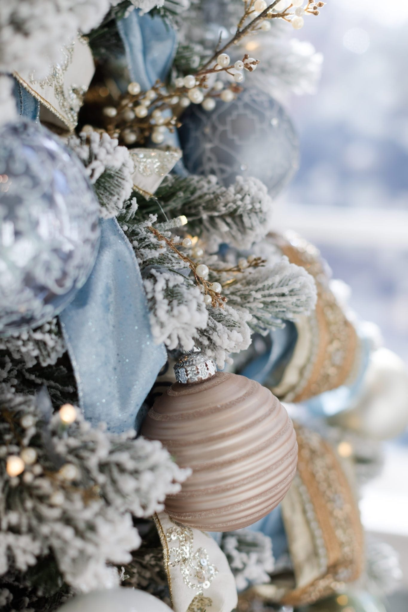 How to decorate a Christmas tree. How to style with tree picks and use gold and blue decorations together.