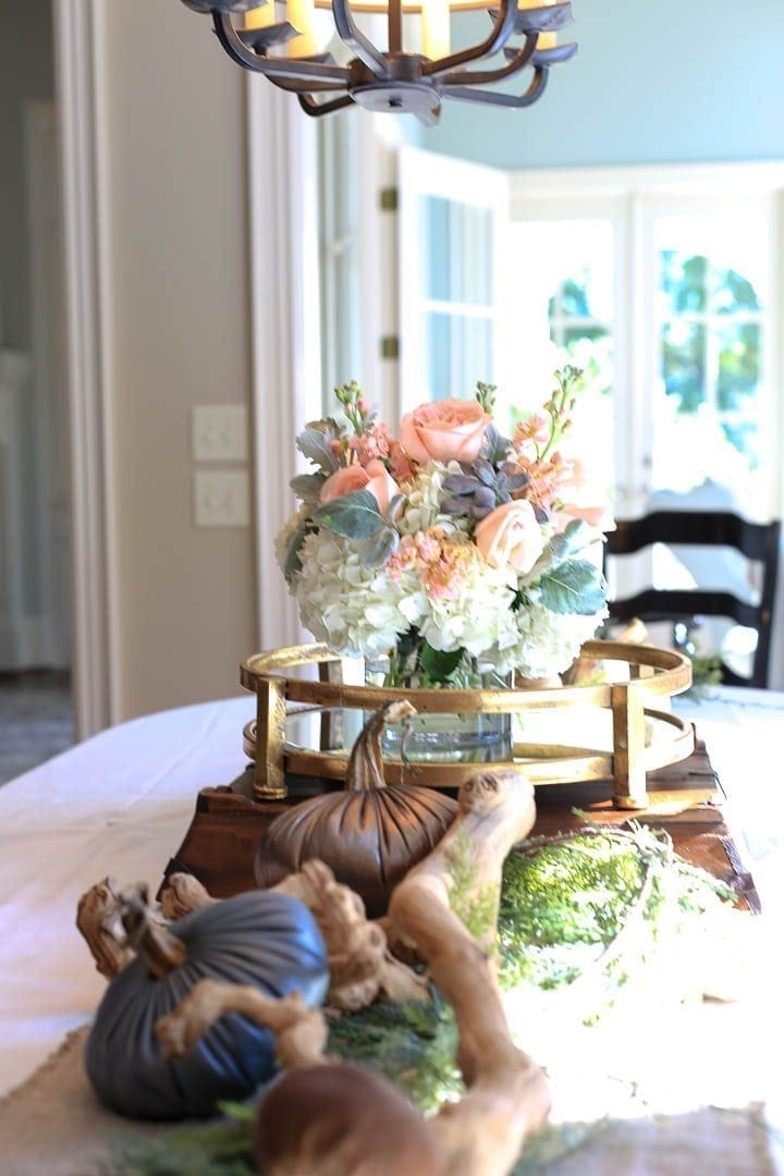 Fall home decor with table decorations for a rectangle table with peach roses and dusty miller.
