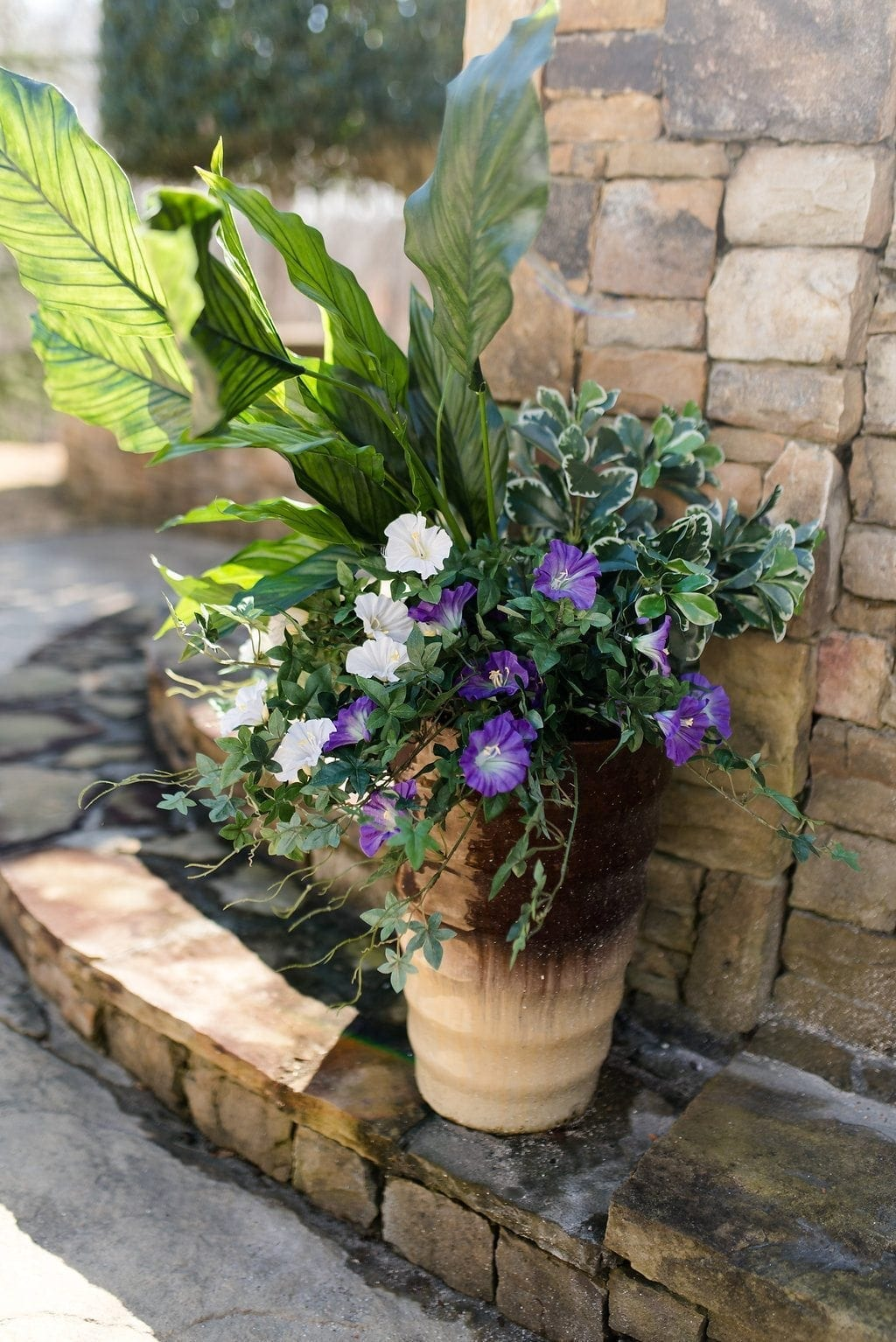 Faux flowers used outside in containers that don't get enough water or sun.