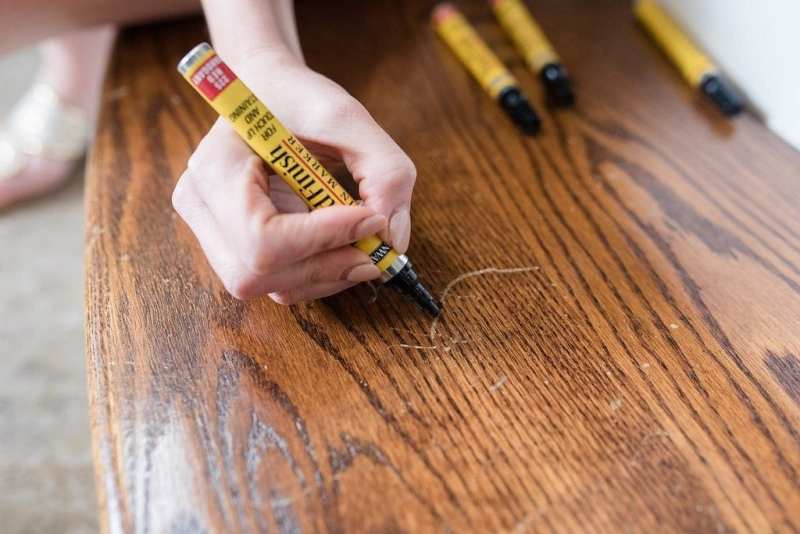 How to use wood finish stain marker in your house for easy way to cover up scratched floors.